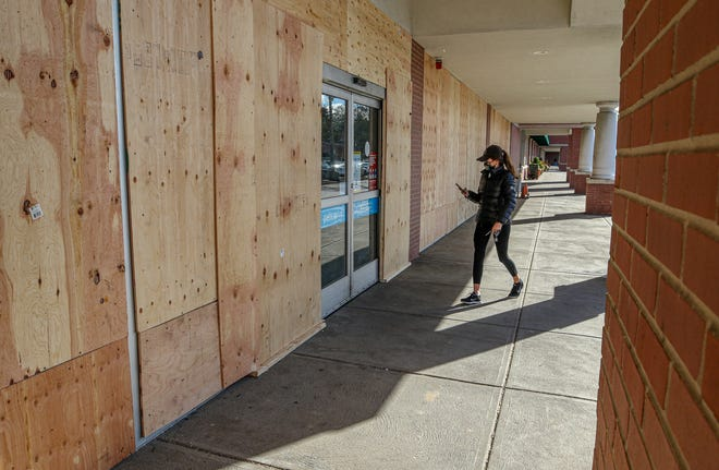 All of the windows at Petco's store at University Heights in Providence were boarded up late last week in response to what turned out to be bogus social-media alerts to a riot that never materialized. The plywood will stay up for a while longer against the possibility that civil unrest will follow Tuesday's presidential election.