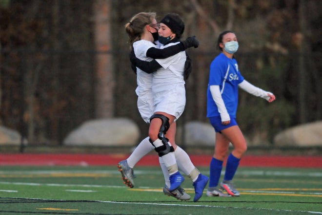 Burrillville's Alex Trimble, left, hugs Emma Withington after Withington scored the go-ahead goal in the Broncos' 3-1 win over Scituate on Monday.