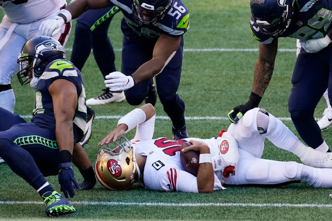 San Francisco 49ers quarterback Jimmy Garoppolo reacts after he was sacked by Seattle Seahawks middle linebacker Bobby Wagner during the first half in Seattle.