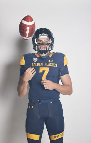Kent State senior quarterback Dustin Crum is pictured in his new No. 7 uniform. He wore No. 14 last season, when Crum led the Golden Flashes to a winning season (7-6) and to their first-ever bowl victory.