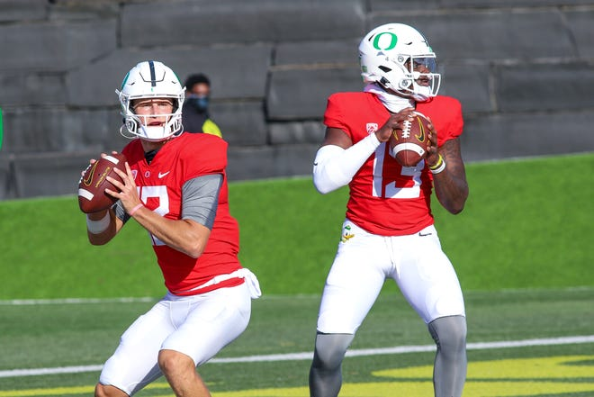 Oregon Ducks quarterbacks Tyler Shough, left, and Anthony Brown (13) prepare to throw during a recent fall camp practice.