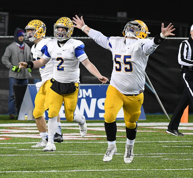 Clyde seniors Ryan Lozier (2) and Trent Cook race to the sidelines at the end of the Fliers win in the OHSAA Division IV State Football Final at Tom Benson Hall of Fame Stadium in Canton, Dec. 7, 2019.  (CantonRep.com / Ray Stewart)