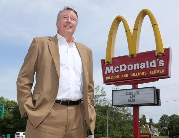 Tom Locke, owner operator with Tomtreyco, stands in front of a McDonald's in Canton Township in this 2019 file photo.