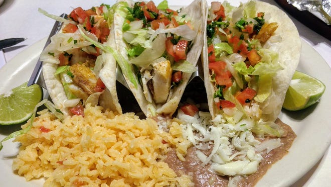 Grilled tilapia tacos with rice and refried beans at Sol.