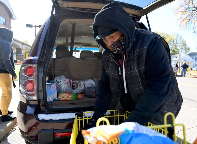 Volunteers, including Rodney DeGraffinreed keep the food pantry at Canton Calvary Mission running.  Monday, November 02, 2020.