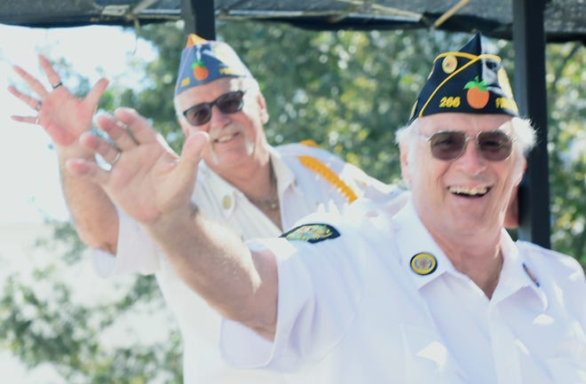 John Covert and Ernie Sheffield wave from the American Legion Post 266 ride at the Sarasota Veterans Day Parade in 2019. Although the parade is not scheduled to take place this year because of the coronavirus pandemic, other local Veterans Day events are, both in person and virtually.