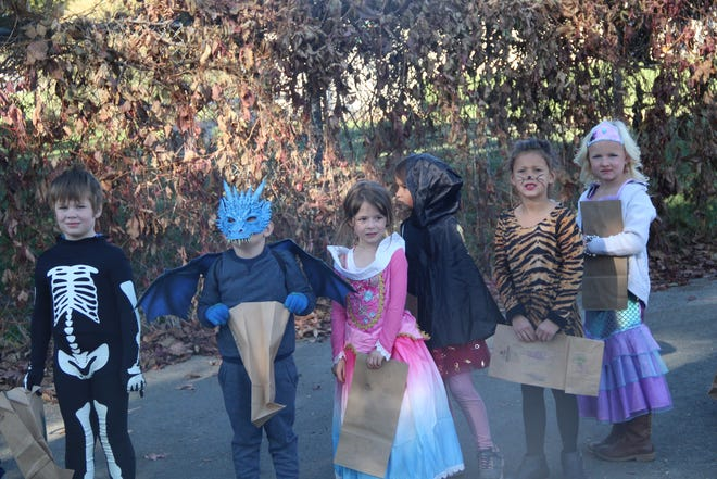 First-graders take part in Grenada School's Halloween parade on Friday.