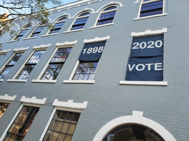 "Signs reading ""1898. 2020. Vote."" can found in the second story of the building at Front and Market streets in downtown Wilmington, and reference the 1898 Wilmington massacre ahead of the election."