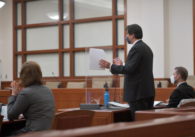 Lawyer Jeffrey Pyle, representing the Telegram & Gazette in its lawsuit against the city of Worcester over its refusal to release police disciplinary records, gestures Monday during his opening statement in Worcester Superior Court.