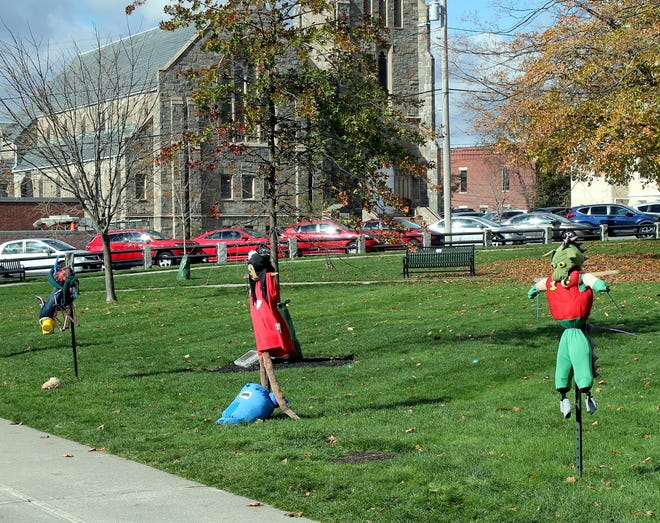 Scarecrows, put up in Clinton's Central Park as part of a Parks and Recreation program, line the Union Street sidewalk.