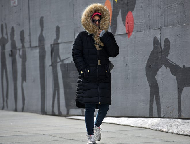 WORCESTER - A woman is bundled up against the cold as she walks along Mercantile Street on Monday.
