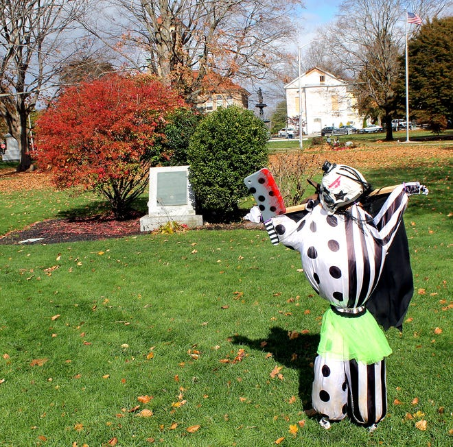 The scarecrows, put up in Clinton's Central Park through a Parks and Recreation program, survived Halloween and the high winds and rain that followed.