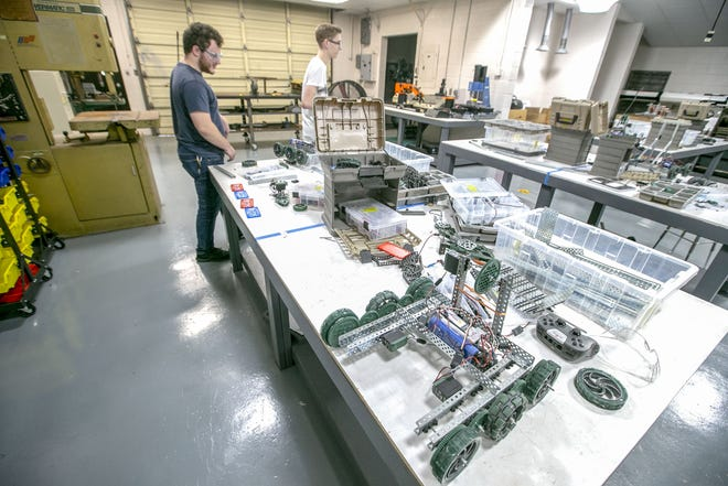 Students work in the Academy of Robotics and Engineering at Loften High School in Gainesville.