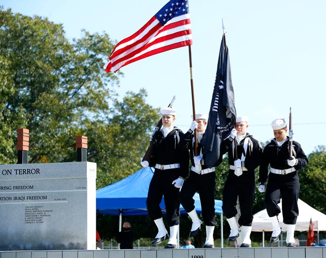 Member of the United States Navy Sea Cadets Liberty Division present the colors during the Veterans Day event at Alachua County Veterans Memorial Park in 2017.