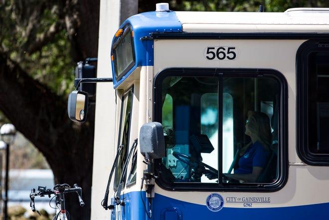 A Regional Transit System bus stops at a traffic light.