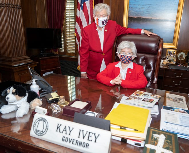 Gov. Kay Ivey poses with Cate McGriff, a John Jones Elementary student who dressed as Alabama's governor for Halloween.