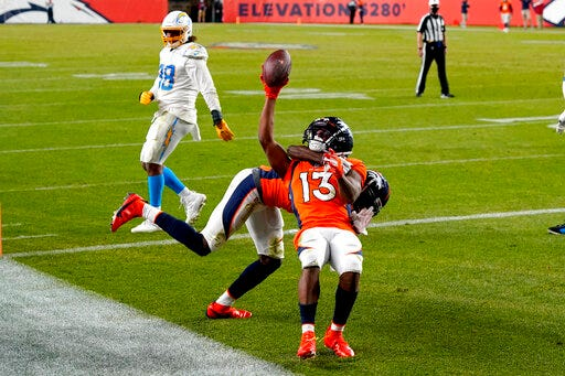 Denver Broncos wide receiver K.J. Hamler, right, scores the game-tying touchdown against the Los Angeles Chargers on Sunday at Empower Field at Mile High in Denver. The Broncos won 31-30. (AP Photo/David Zalubowski)
