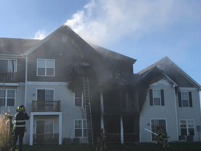 Firefighters from the Columbus Division of Fire and the Norwich and Washington township fire departments suppress a fire Nov. 2 at the Avery Pointe Apartments in Hilliard, near Avery and Davidson roads.