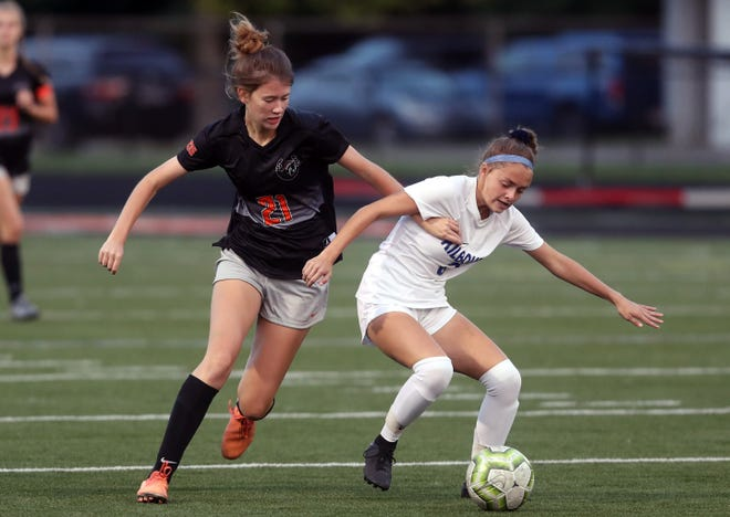 Senior forward Alyssa Griner, left, was special mention all-league for the Delaware Hayes girls soccer team. The Pacers made history this season, capturing the program's first league championship.