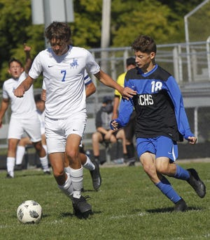 Junior forward/midfielder Charlie Turek, left, helped the Ready boys soccer team improve by four wins this fall. The Silver Knights also won a postseason game for the first time since 2014.