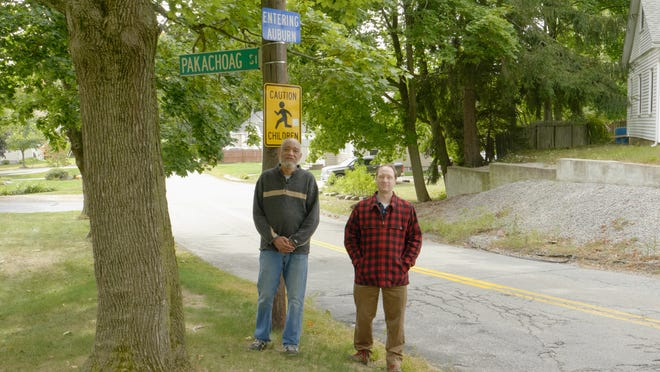 Thomas Doughton, left, and Colin Novick during their walking tour of the Pakachoag area featured in the film.