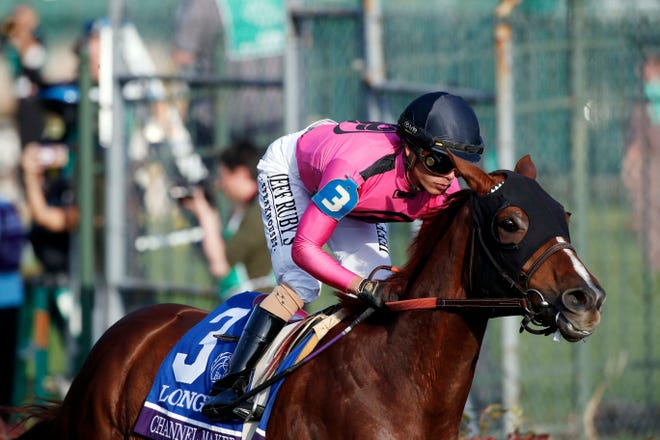 Jose Ortiz aboard Channel Maker goes the through the first turn in the Longines Breeders Cup Turf during the 35th Breeders Cup world championships at Churchill Downs.