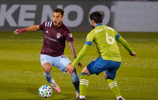 Colorado Rapids forward Andre Shinyashiki, left, works the ball past Seattle Sounders midfielder Joao Paulo in the first half of an MLS soccer match Sunday, Nov. 1, 2020, in Commerce City, Colo.