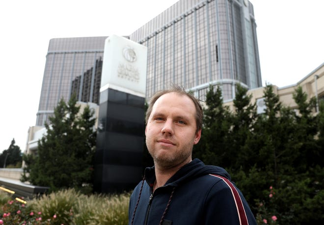 Jeff Zaniewski, 33, of Clinton Township in front of the MGM Grand Detroit on Friday. For years Zaniewski gambled at MGM once a week until he asked to join Michigan's Disassociated Persons List in 2017. There are more than 4,800 people who volunteer for the list, which bans them from entering the three Detroit casinos.