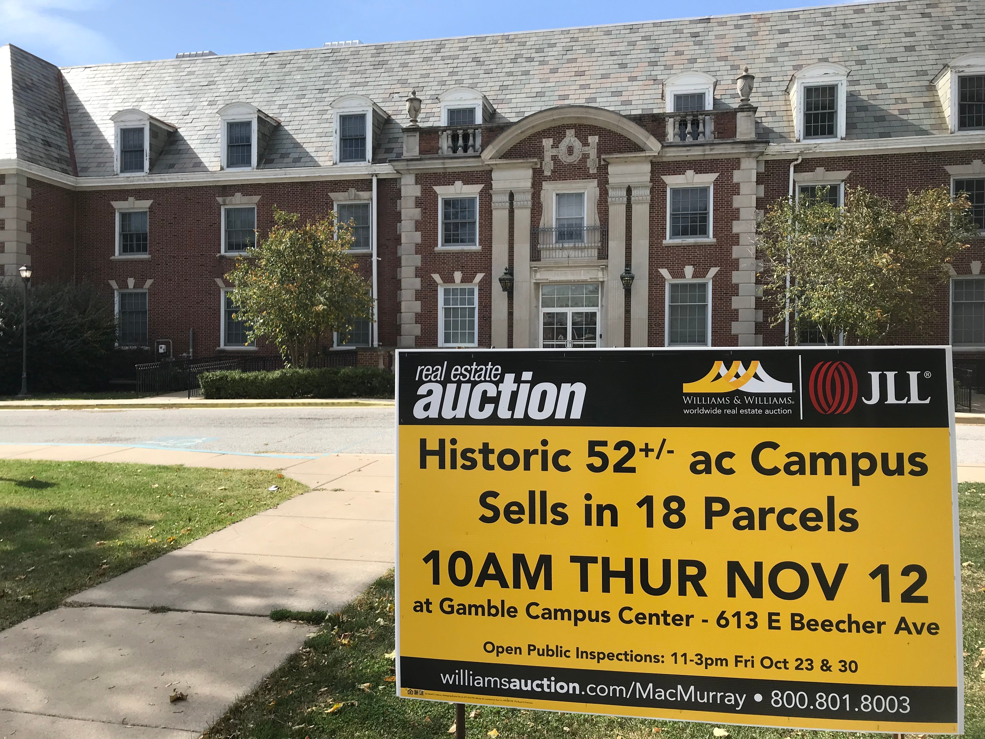 An auction sign sits on the campus of MacMurray College. The private liberal arts college, in rural Illinois, closed in May.