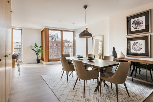 An elegant fixture adds appeal in this dining area.