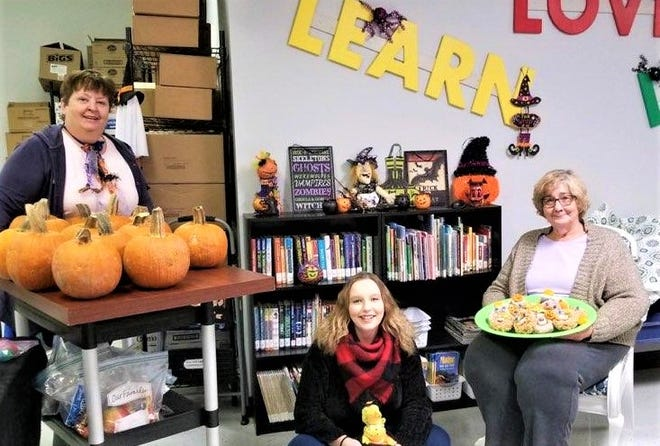The Ottawa County Family Advocacy Center's Grandlove project held a Halloween party for kids being raised by grandparents. Left to right are Living Out Loud program coordinators Rosalyn Barnhill, Cassidy Steinmetz and Judy Peters.