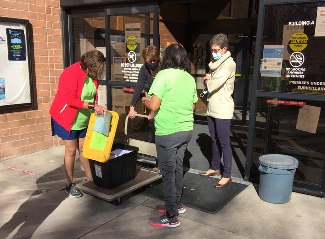 PATHS members deliver an estimated 8,000 signatures to the Fort Collins City Clerk's Office in support of a Hughes Stadium ballot measure on Monday, Nov. 2, 2020.