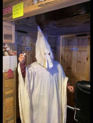 A man reportedly dressed as a Ku Klux Klansman visited bars in Glasgow on Halloween.