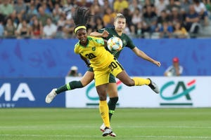Jamaica's Cheyna Matthews, foreground, fights for the ball with Australia's Steph Catley during the Women's World Cup Group C soccer match between Jamaica and Australia at Stade des Alpes stadium in Grenoble, France, Tuesday, June 18, 2019.