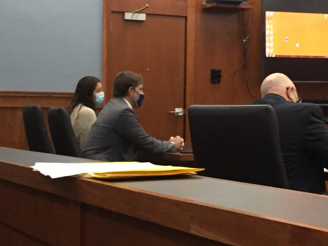 Erin Underwood sits with defense attorney James Mayer III at her sentencing Monday. Richland County Prosecutor Gary Bishop is at the right.