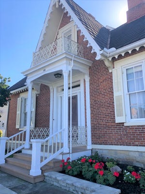 Lovely fretwork details grace the gable and roofline of the Henry True Home.