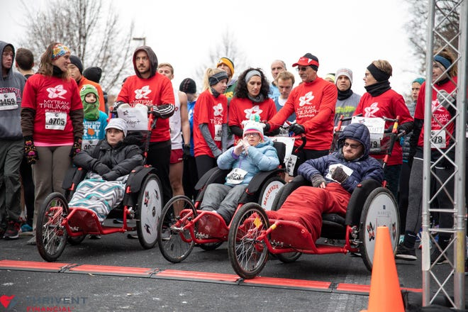 myTeam Triumph awaits the start of the 2019 Burlington Turkey Trot. The team is registered to participate again this year.