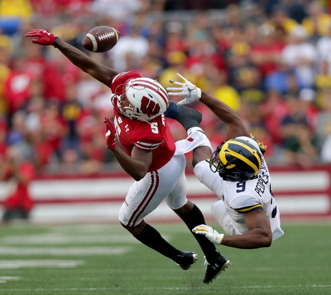 Wisconsin cornerback Rachad Wildgoose knocks away a pass intended for Michigan wide receiver Donovan Peoples-Jones during the teams' 2019 game in Madison.