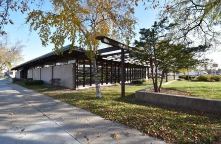 Historic status for the former Forest Home Branch Library could block plans to demolish the building for a new medical clinic.