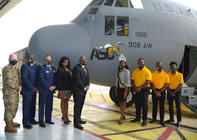 Members of the 908th Airlift Wing and representatives of Alabama State University pose for a photo in front of the newly unveiled ASU nose art at Maxwell Air Force Base, Alabama. The 908th AW commemorated its partnership with ASU by painting the university's logo on the nose of one of its C-130 H aircraft.
