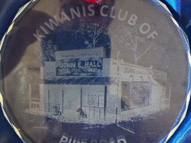 The Kiwanis Club of Pike Road is selling Christmas ornaments to provide college scholarships for Pike Road students. The ornaments cost $20 and feature artist Bruce Brannen's most popular drawings of Pike Road history. The first etched glass ornament highlights Brannen's drawing of the John Hall Grocery.