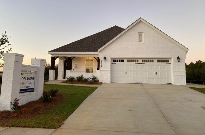 A model home sits in McClain Landing in east Prattville. Construction started in McClain in 2020. One-story, ranch-style homes and two-story traditional designs are under construction on flat terrain in the Stone Martin Builders development located off McQueen Smith Road.