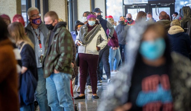 Voter wait in line on Monday, Nov. 2 at the Delaware County Government Complex during the last day of early voting. Nearly 150 voters were still in lines as the lines were closed. Anyone in line before noon was able to cast a ballot after the cutoff.