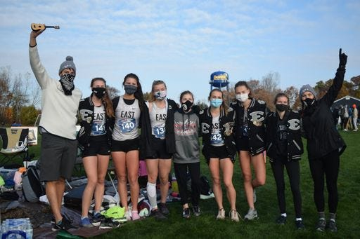 South Lyon East runners celebrate advancing to states.