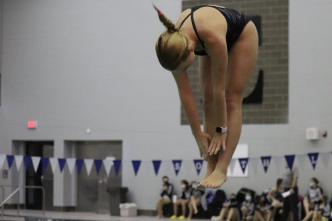 Kate Benjamin took first place in the dive competition for South Lyon East on Oct. 27