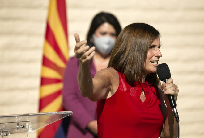 U.S. Sen. Martha McSally, R-Ariz., speaks during a campaign event at the Arizona Republican Party headquarters in Phoenix on Nov. 2, 2020. State Treasurer Kimberly Yee (background) looks on.