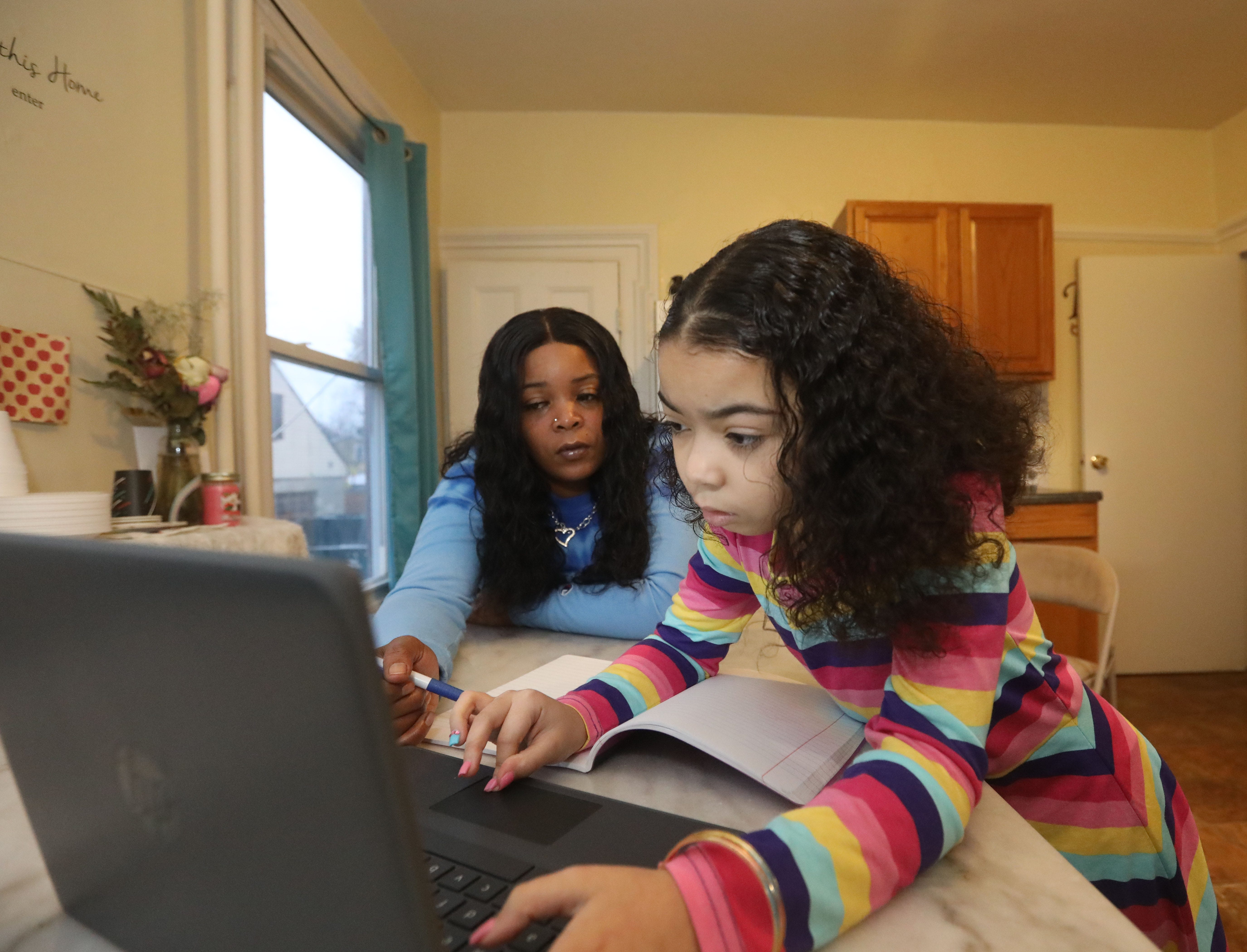 The pandemic further complicated difficult situations faced by New York families. Kenda Smith, shown here helping her daughter, Diamond Yeno with a math assignment in October, recently regained custody of her and is navigating their relationship along with financial hardship.