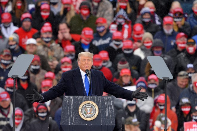 President Donald Trump addresses supporters during his Make America Great Again Victory Rally at AV Flight at the Capital Region International Airport in Lansing, Michigan on Tuesday, Oct. 27, 2020. (Todd McInturf/The Detroit News/TNS)