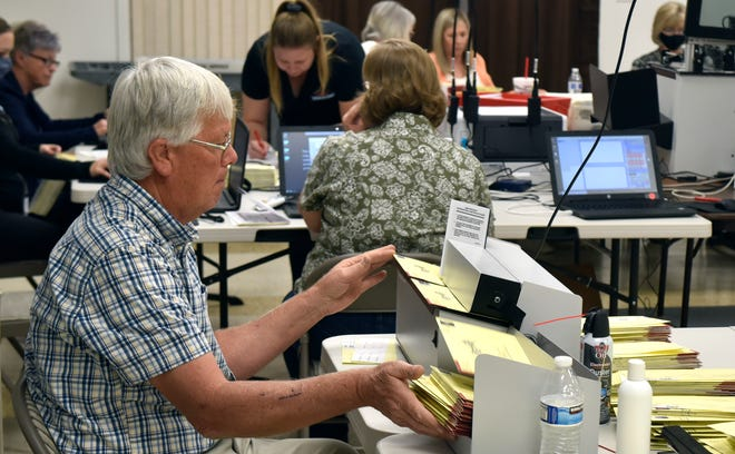 Washington County Recorder Kim Hafen sorts ballots inside the county's ballot processing center in St. George.