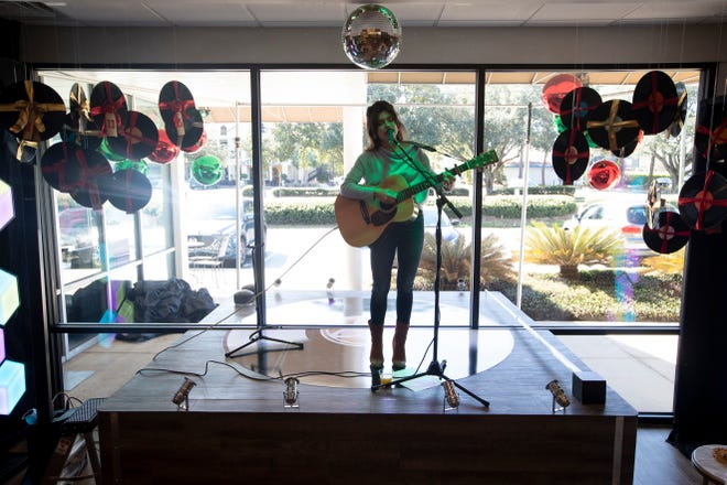 """Hearth and Soul revealed its 2020 holiday advent calendar window with the musical theme of """"Rockin' Around the Hearth"""" Monday, Nov. 2, 2020, with a performance from local singer Madison Avery on an indoor and outdoor stage resembling a turntable."""